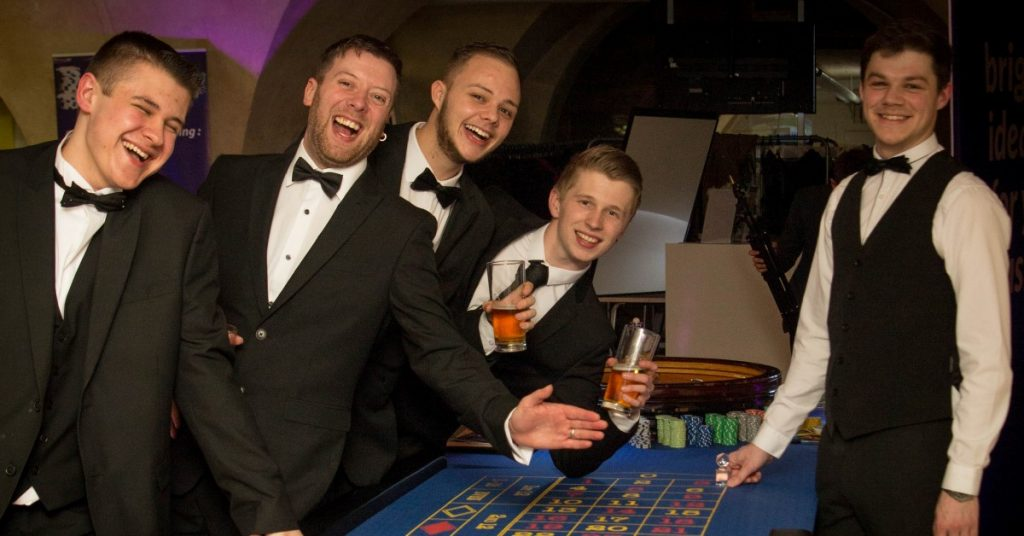 Fun Casino Hire, Gentleman enjoying the Roulette Table.