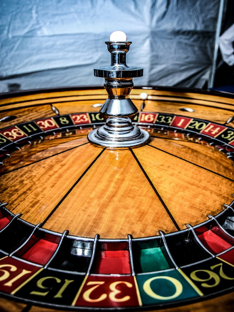 Close up picture of a roulette wheel.