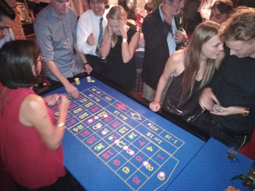 Players talking at a busy roulette table