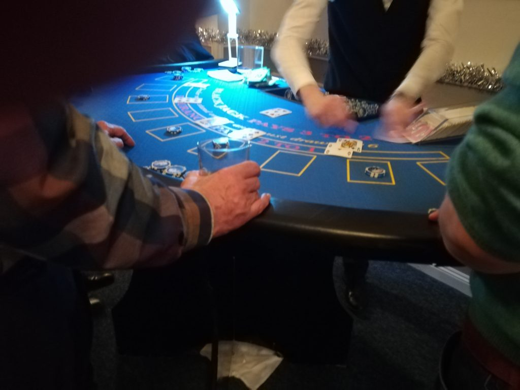 Blackjack Table with dealer in action.